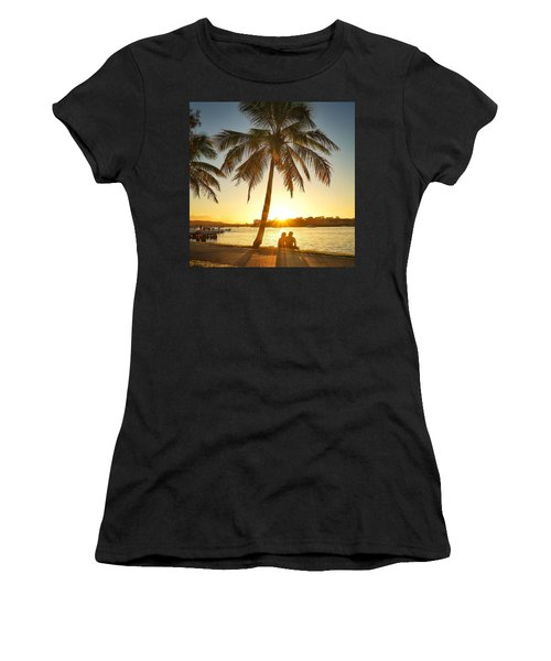 Women's T-Shirt (Athletic Fit) featuring the photograph Sunset Lovers Under Palm Tree And Down By The River by Keiran Lusk
