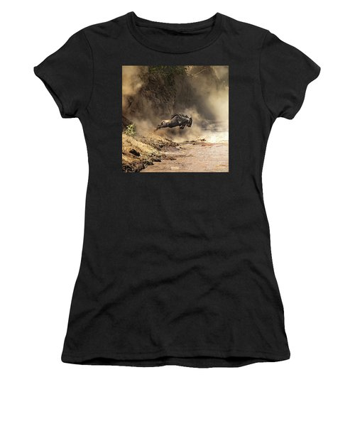 Wildebeest Leaps From The Bank Of The Mara River Women's T-Shirt