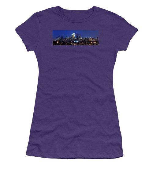 Buildings Lit Up At Night In A City Women's T-Shirt (Junior Cut) by Panoramic Images