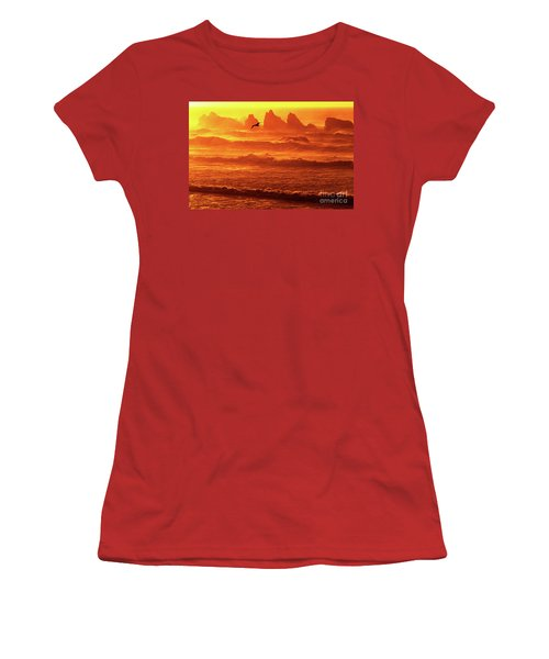 Women's T-Shirt (Junior Cut) featuring the photograph Seagull Soaring Over The Surf At Sunset Oregon Coast by Dave Welling