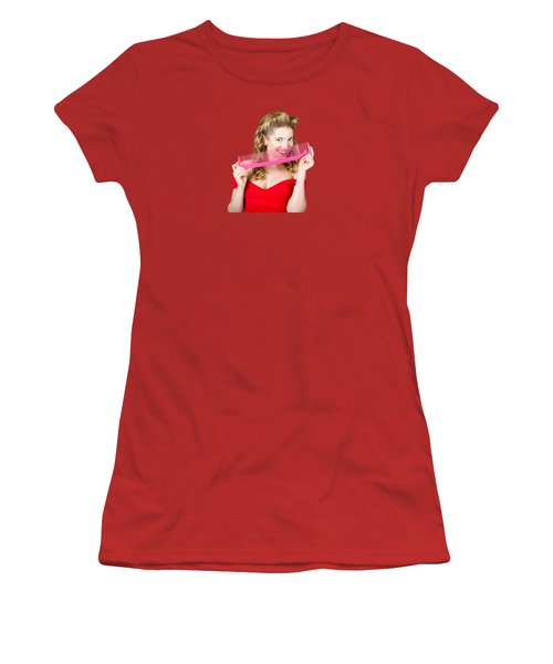 Women's T-Shirt (Junior Cut) featuring the photograph Beauty Salon Pinup Girl Smiling With Haircare Comb by Jorgo Photography - Wall Art Gallery