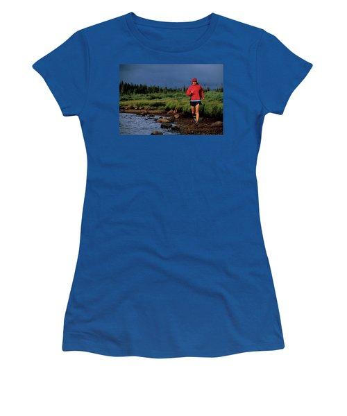 A Woman Trail Runs At Brainard Lake Women's T-Shirt