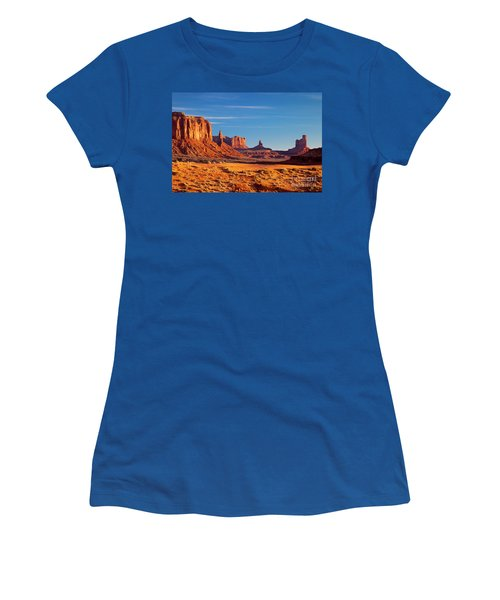 Women's T-Shirt featuring the photograph Sunrise Over Monument Valley by Brian Jannsen