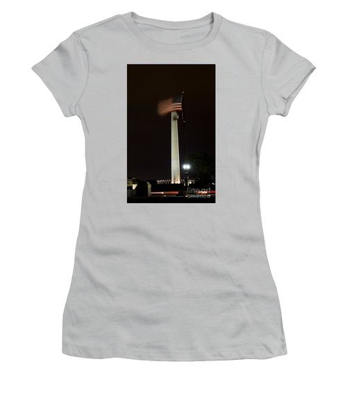Women's T-Shirt (Athletic Fit) featuring the photograph Washington Monument At Night With Flag by Angela DeFrias