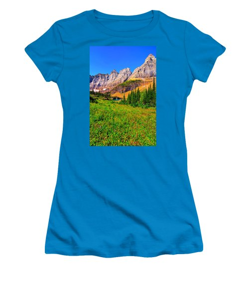 Women's T-Shirt (Junior Cut) featuring the photograph Wildflower Meadow Beneath The Ptarmigan Wall by Greg Norrell