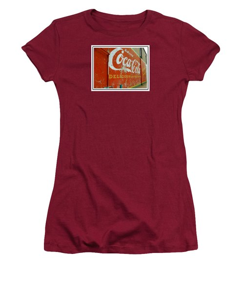 Women's T-Shirt (Junior Cut) featuring the photograph Coca-cola On The Army Store Wall by Kathy Barney