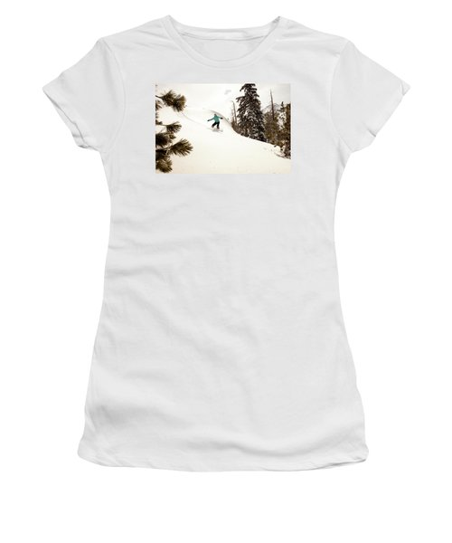 A Female Snowboarder Lays Out Some Women's T-Shirt