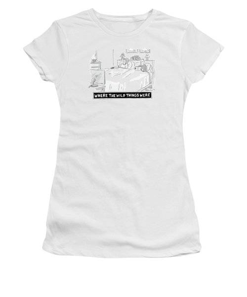 A Man And Woman Lie In Bed. The Man Reads Women's T-Shirt