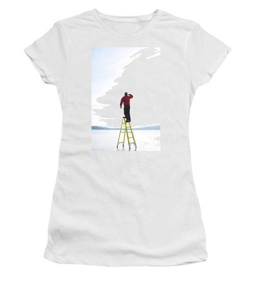 Man Atop Ladder On A Frozen Lake Women's T-Shirt