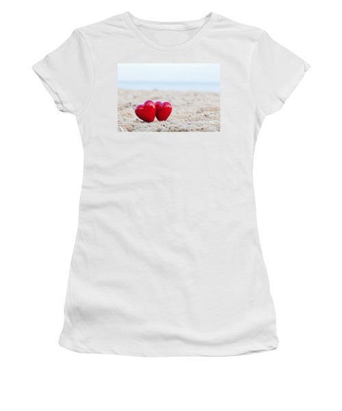 Two Red Hearts On The Beach Symbolizing Love Women's T-Shirt (Junior Cut) by Michal Bednarek