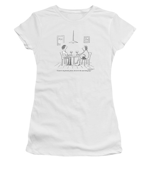 Two Women Sit Across From Each Other At A Small Women's T-Shirt