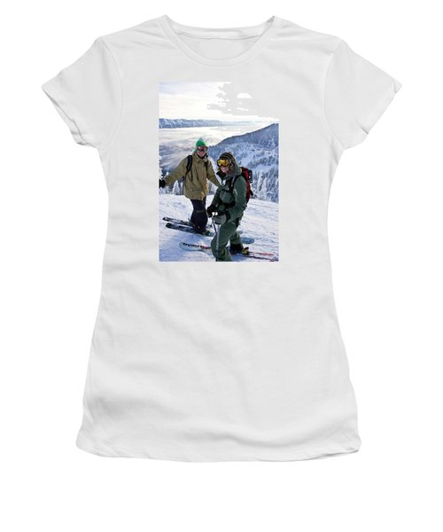 Young Couple Smile At Top Of Ski Run Women's T-Shirt