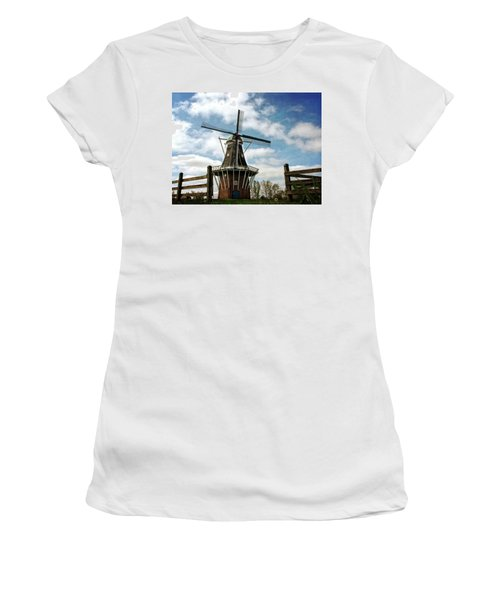 Women's T-Shirt (Athletic Fit) featuring the photograph Dezwaan Windmill With Fence And Clouds by Michelle Calkins