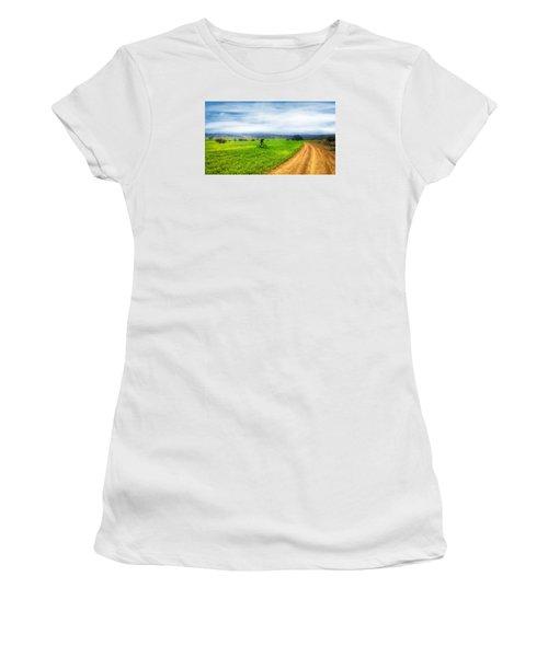 Mountain Biker Cycling Through Green Fields Women's T-Shirt (Athletic Fit)