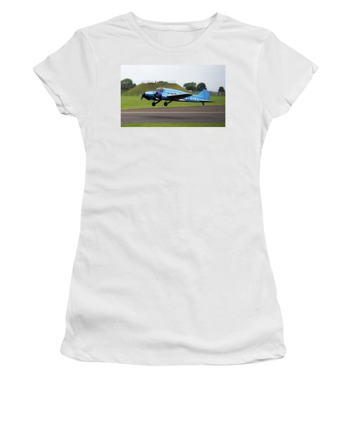 Women's T-Shirt (Athletic Fit) featuring the photograph Raf Scampton 2017 - Avro Anson Nineteen During Take Off by Scott Lyons