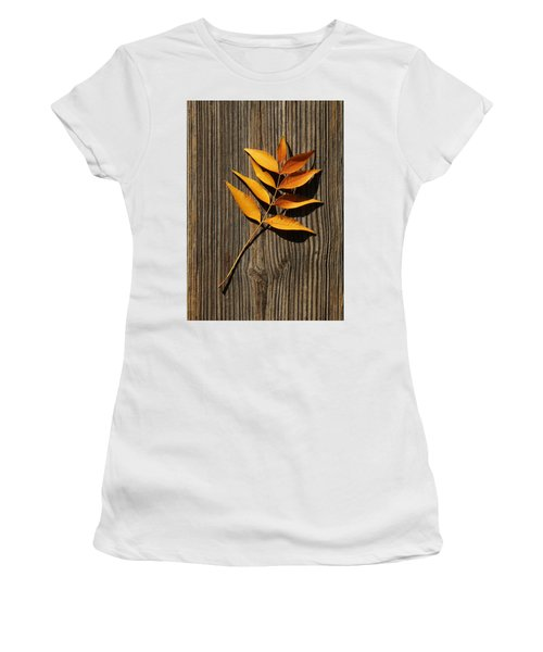 Women's T-Shirt featuring the photograph Golden Autumn Leaves On Wood by Debi Dalio