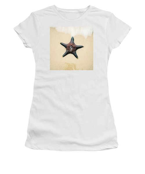 Women's T-Shirt featuring the photograph Starfish On The Beach Sand. Close Up. by Rob D Imagery