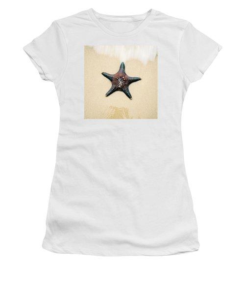 Starfish On The Beach Sand. Close Up. Women's T-Shirt