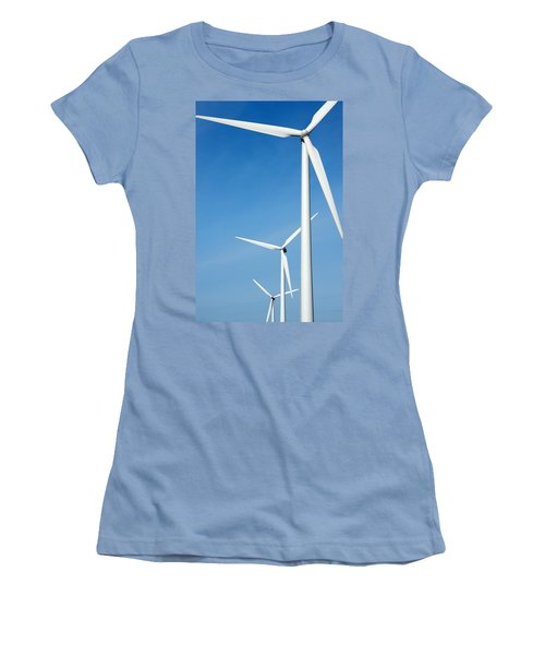 Three Mighty Windmills In A Row Against A Blue Sky. Women's T-Shirt (Athletic Fit)