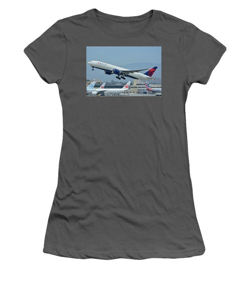 Women's T-Shirt (Junior Cut) featuring the photograph Delta Boeing 777-232lr N703dn Los Angeles International Airport May 3 2016 by Brian Lockett