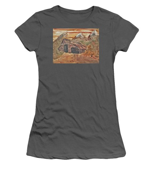 Old Farmhouse With Hay Stack In A Snow Capped Mountain Range With Tractor Tracks Gouged In The Soft  Women's T-Shirt (Junior Cut) by MendyZ