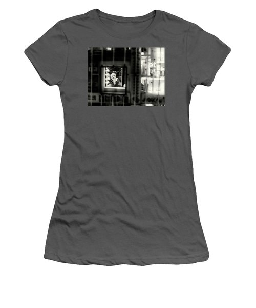 Women's T-Shirt (Athletic Fit) featuring the photograph Shopkeeper At Night by John Williams