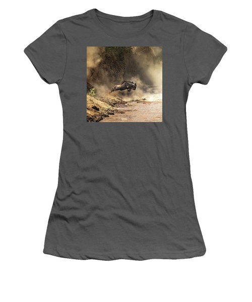 Wildebeest Leaps From The Bank Of The Mara River Women's T-Shirt (Athletic Fit)
