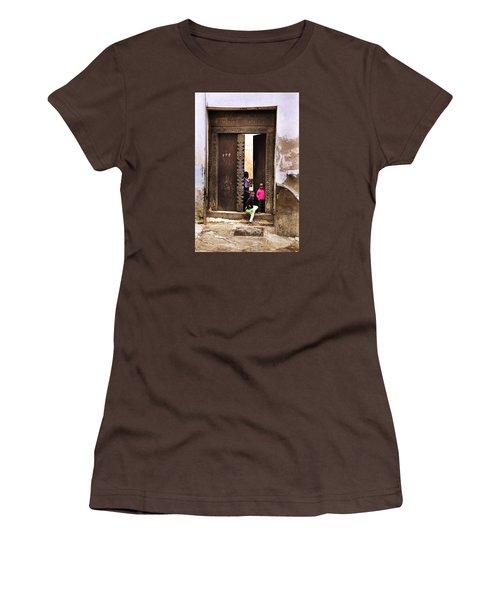 Women's T-Shirt (Junior Cut) featuring the photograph Kids Playing Zanzibar Unguja Doorway by Amyn Nasser
