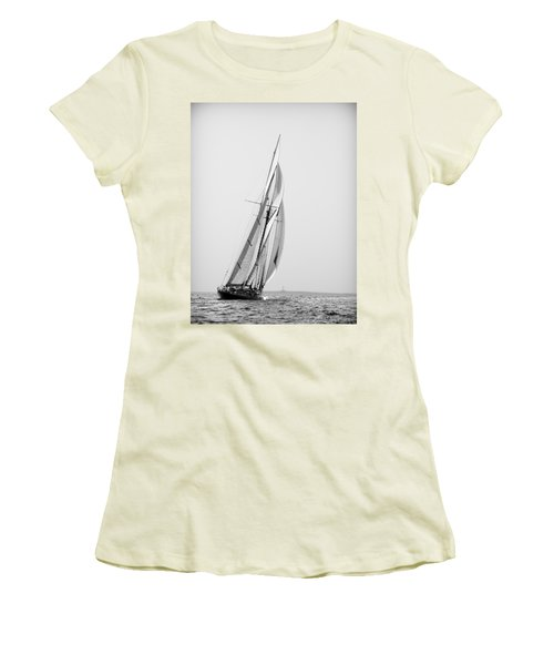 A Tall Ship In Mediterranean Water Approaching To Lighthouse Of Isla Del Aire - Menorca Women's T-Shirt (Junior Cut) by Pedro Cardona