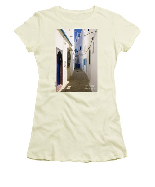 Women's T-Shirt (Junior Cut) featuring the photograph Narrow Backstreet In The Medina Of Asilah On Northwest Tip Of Atlantic Coast Of Morocco by Ralph A  Ledergerber-Photography