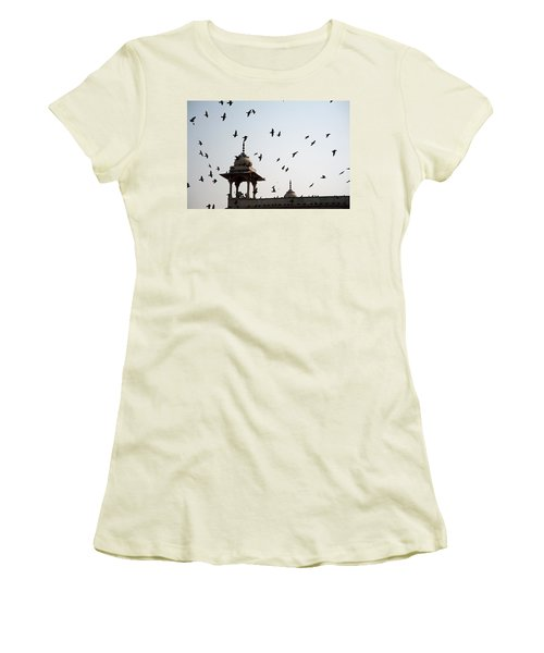 Women's T-Shirt (Junior Cut) featuring the photograph A Whole Flock Of Pigeons On The Top Of The Ramparts Of The Red Fort In New Delhi by Ashish Agarwal