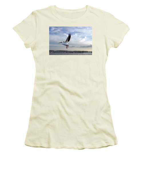 Women's T-Shirt (Junior Cut) featuring the photograph White Pelican Flying Over Island by Dan Friend