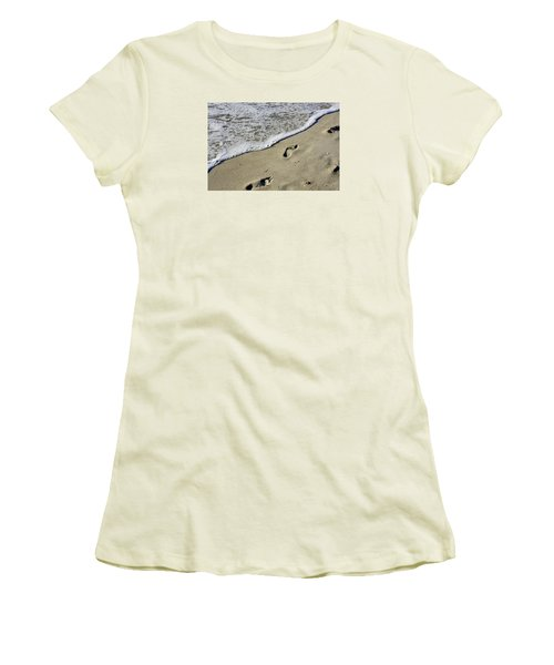 Women's T-Shirt (Junior Cut) featuring the photograph Footprints On The Beach by Robb Stan