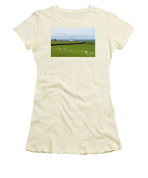 Women's T-Shirt (Junior Cut) featuring the photograph Sheep Grazing On Irish Coastline by Juli Scalzi