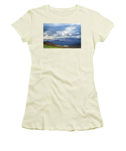 Women's T-Shirt (Junior Cut) featuring the photograph Sun Rays Piercing Through The Clouds Touching The Irish Landscap by Semmick Photo