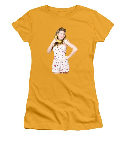 Women's T-Shirt (Junior Cut) featuring the photograph Retro Pin Up Girl Chatting On Banana Telephone by Jorgo Photography - Wall Art Gallery