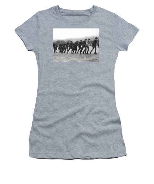 A Line Of Ice Skaters Women's T-Shirt