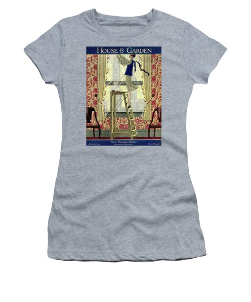A Young Matron Adjusting Curtains Women's T-Shirt