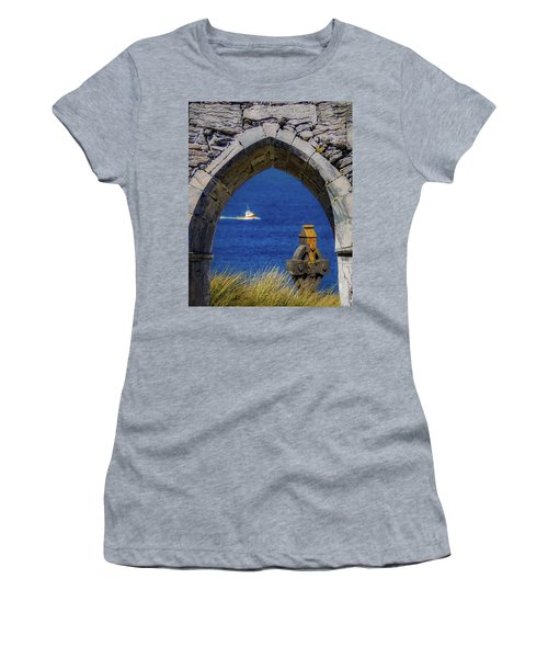 Women's T-Shirt (Athletic Fit) featuring the photograph Celtic Cross And Fishing Vessel From Isle Of Inisheer by James Truett