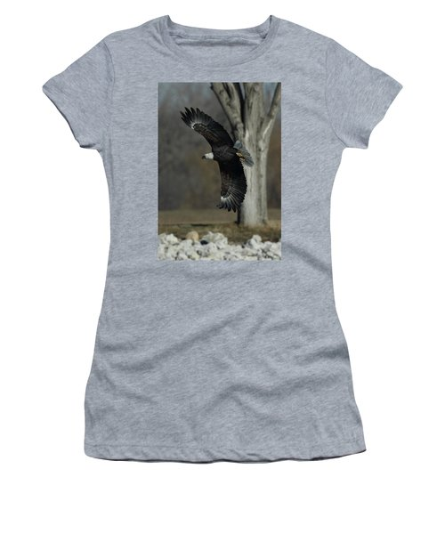Women's T-Shirt (Junior Cut) featuring the photograph Eagle Soaring By Tree by Coby Cooper