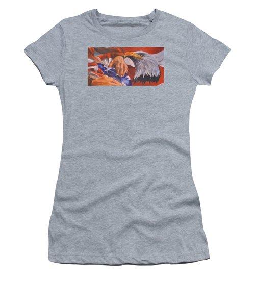Family Receives Flag Women's T-Shirt (Junior Cut) by Ken Pridgeon