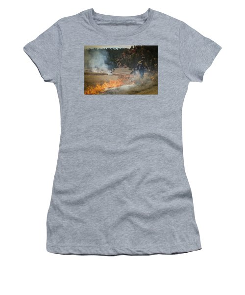 Women's T-Shirt featuring the photograph Firefighter Ignites The Pleasant Valley Prescribed Fire by Bill Gabbert