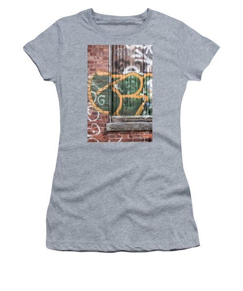 Women's T-Shirt (Athletic Fit) featuring the photograph Graffiti Covered Wall Of An Old Abandoned Factory by Edward Fielding