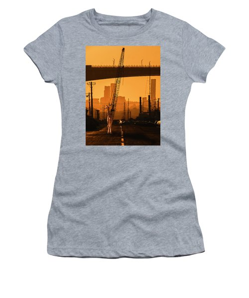 Women's T-Shirt featuring the photograph Baby Giraffe In The Urban Jungle. by Rob D Imagery