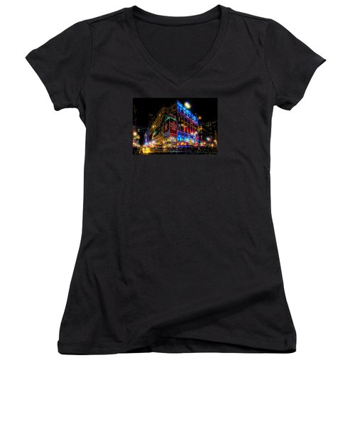 A December Evening At Macy's  Women's V-Neck T-Shirt (Junior Cut) by Chris Lord