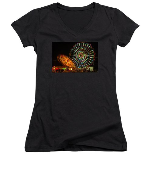 Women's V-Neck T-Shirt (Junior Cut) featuring the photograph Colorful Carnival Ferris Wheel Ride At Night by Jerry Cowart