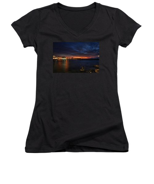 Women's V-Neck T-Shirt (Junior Cut) featuring the photograph a flaming sunset at Tel Aviv port by Ron Shoshani