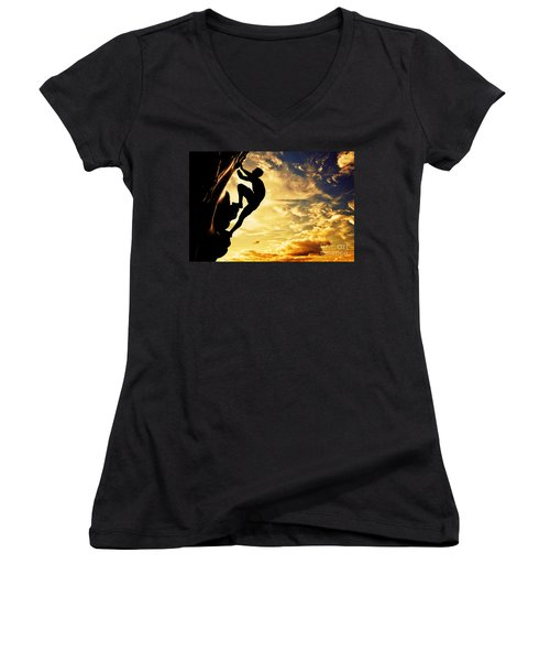 A Silhouette Of Man Free Climbing On Rock Mountain At Sunset Women's V-Neck T-Shirt