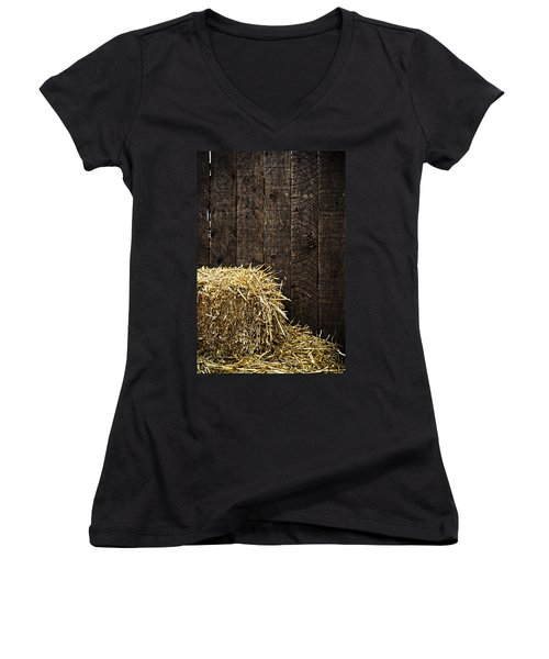 Bale Of Straw And Wooden Background Women's V-Neck