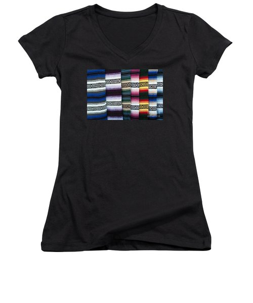 Women's V-Neck T-Shirt (Junior Cut) featuring the photograph Colorful Indian Rug Display by Gunter Nezhoda